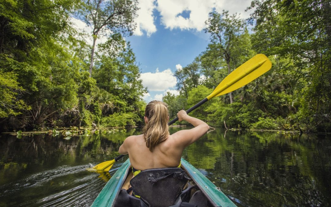 woman-kayaking-down-a-river