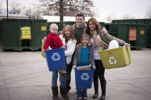 Family recycling shows the need for environmental public relations for green causes.