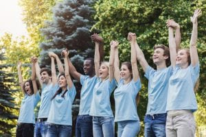 Nonprofit foundation members celebrating outside