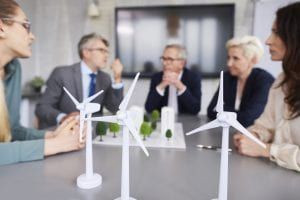 Company plans 2020 sustainability goals with turbine models in foreground