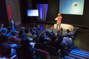 Sustainability thought leader addressing audience at green conference
