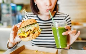 Customer tries new vegan burger and smoothie