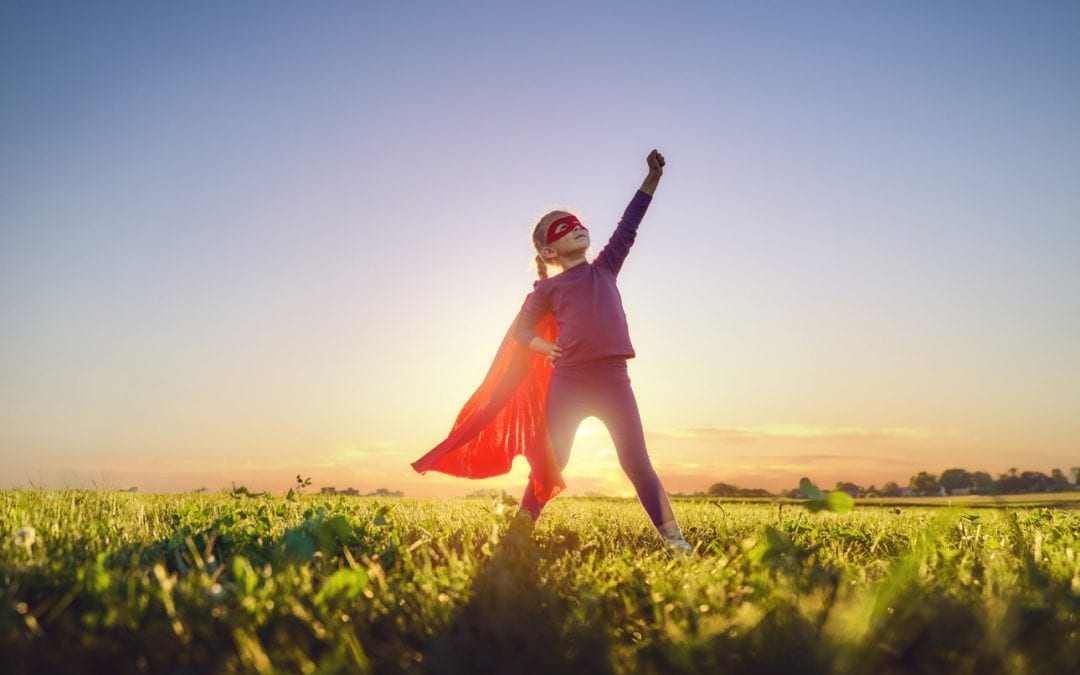Girl playing superhero in a field is a vegan champion