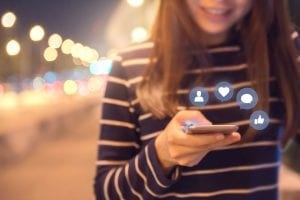 woman on social media, LinkedIn to Boost Your Plant-Based Business