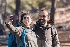 two ecotourists taking selfie