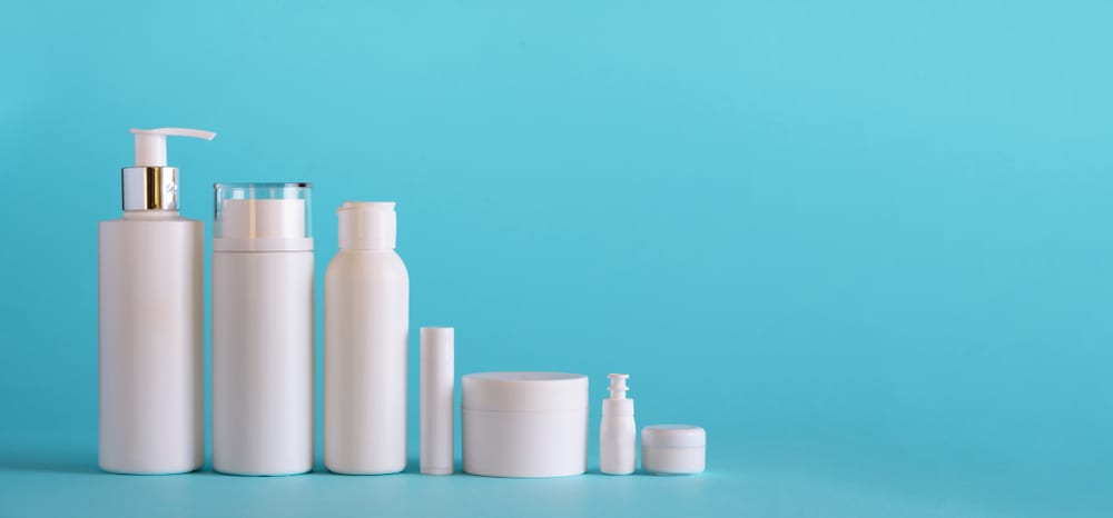 Makeup-lotion-containers-against-blue-background